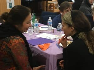 Two women have a conversation