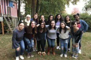 A group of Muslim and Jewish teenagers pose together for a group photo