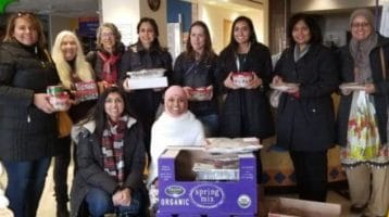 Muslim and Jewish women gathered and carrying baked goods