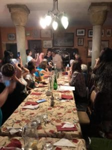 Muslim and Jewish women gathered for dinner at long tables in a mosque