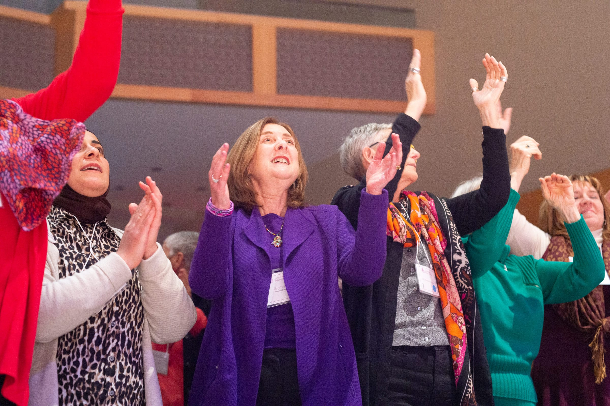 women clapping in song