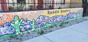 mural wall with a desert scene and the words, Radiate Kindness