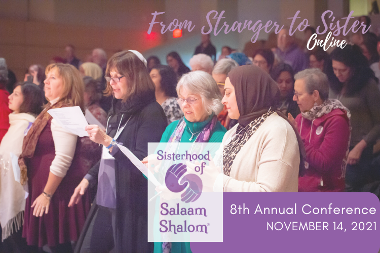 Women holding song sheets gathered, standing, in an auditorium, with From Stranger to Sister Online at the top of the photo and Sisterhood of Salaam Shalom 8th Annual Conference November 14, 2021 at the bottom